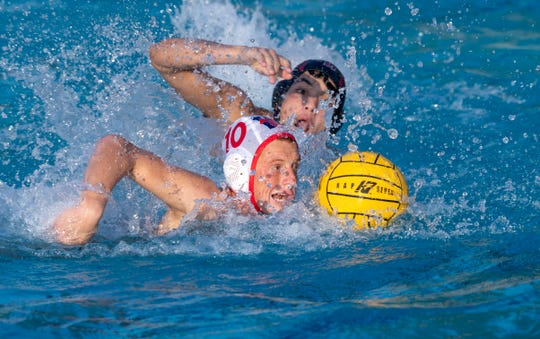 Tulare Western's Aidan Champagne advances against Mt. Whitney in a Central Section Division III boys water polo championship on Saturday, November 16, 2019.