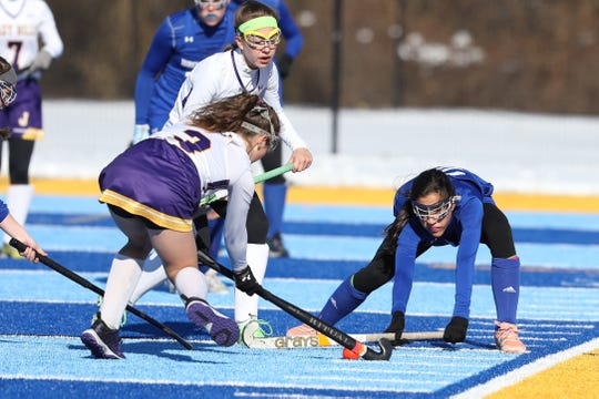Bronxville Olivia Gunther flattens her field hockey stick to block the shot of Johnstown Emily Pertell.