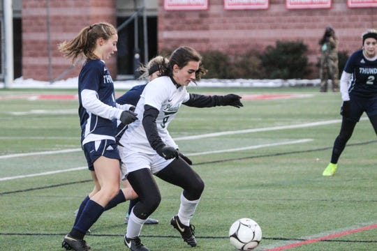 Pleasantville's Mary Grace O'Neill shields the ball from a couple of Central Valley Academy defenders during the Class B championship game at SUNY Cortland on Sunday, Nov. 17, 2019.