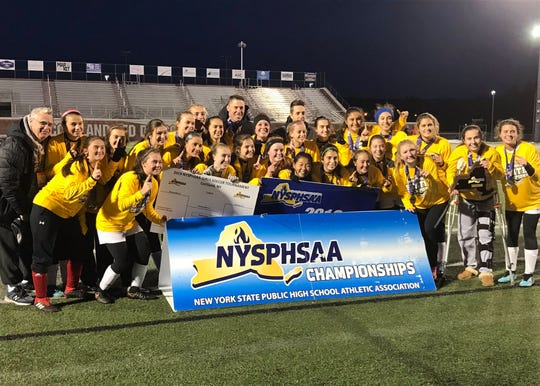 The Pleasantville Panthers pose with the championship plaque after defeating Central Valley Academy, 3-2, in the Class B state championship game at SUNY Cortland on Sunday, Nov. 17, 2019.