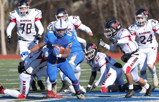 Ardsley's Jalen Osbourne (6) is chased down by a host of Port Jervis defenders in the Class B semifinal at Mahopac High School Nov. 16, 2019. Port Jervis won the game 20-14.