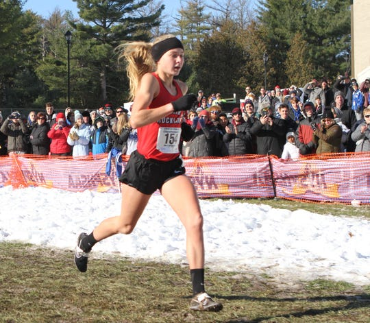 Katelyn Tuohy heads for the finish and her third Class A cross-country state championship.