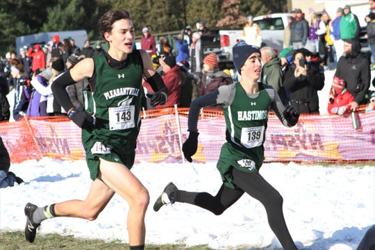 Hastings' Aidan Gemme (r) edges Pleasantville's Aidan Lynch (l) for 12th place in the 132-runner boys Class C race.