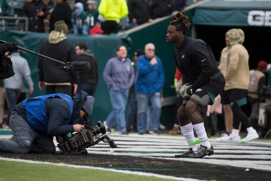 Eagles' Jay Ajayi (28) warms up before facing the Patriots Sunday at Lincoln Financial Field.