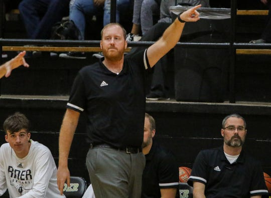 Rider head basketball coach Cliff McGuire give direction to his players in the game against Keller Saturday, Nov. 16, 2019, at Rider.
