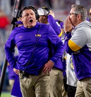 LSU football coach Ed Orgeron yells during the Nov. 16 game against Ole Miss.