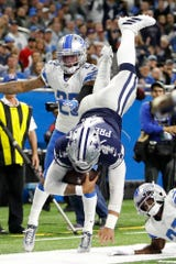 Cowboys quarterback Dak Prescott (4) did just about everything in Sunday's win over the Lions.