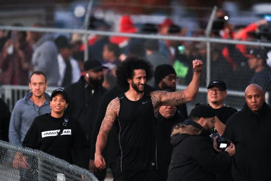 Colin Kaepernick visits with fans following Saturday's workout.