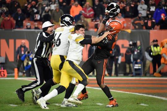 Cleveland Browns defensive end Myles Garrett swings Pittsburgh Steelers quarterback Mason Rudolph's helmet at him on Nov. 14, 2019, in Cleveland.