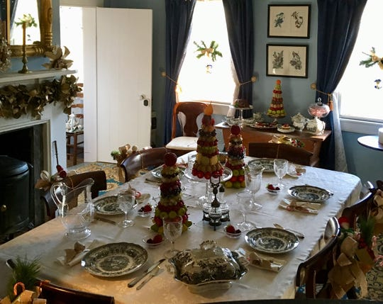 The warmth of the holidays is on display at the Historic Village at Allaire.