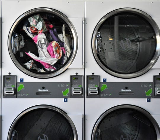 A load of clothes spins in one of the dryers at Wash This Way at 710 Butternut St. on Monday, Nov. 18, 2019.