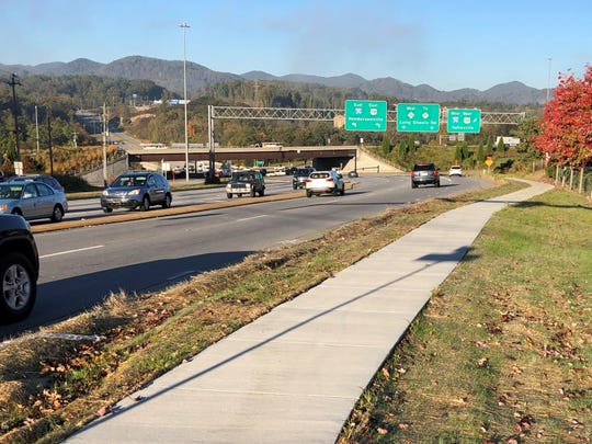 This sidewalk along Long Shoals Road near I-26 eventually will tie into a longer system, but right now it ends just before the interstate ramp.