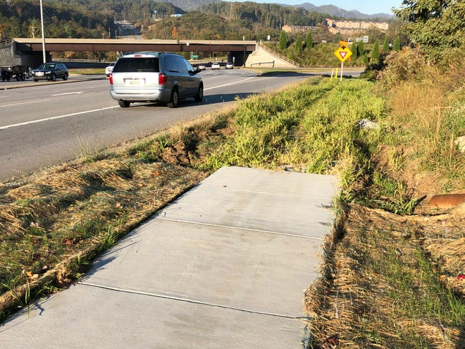The issue of sidewalks in Buncombe County is more complicated than it seems, especially on border areas with the city of Asheville, which used to be able to impose its zoning requirements on the edges of the city. This section of sidewalk on Long Shoals Road is supposed to eventually tie into more.