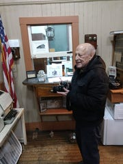 George Allen photographs a teletype machine inside the Vestal Museum. He serves as a volunteer photographer for the museum and the Vestal Fire Department.
