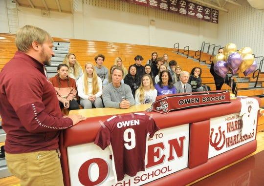 Owen soccer head coach David Fiest congratulates Mikayla Roseman on signing with Western Carolina University on Nov. 13.