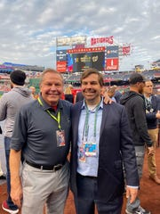Dr. Bruce Thomas, left, and his son, Ryan, played unsung roles to help the Washington Nationals win the World Series.