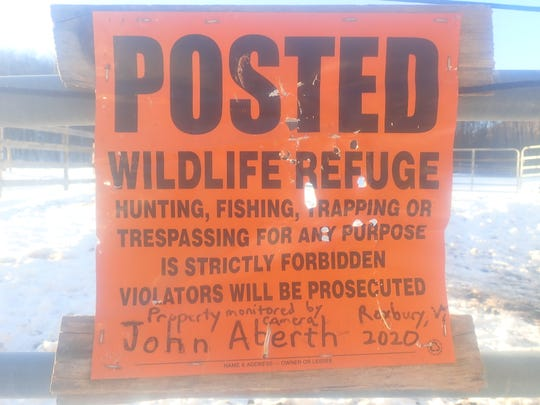 A damaged sign on John Aberth's posted land in Roxbury. Aberth says hunters shot at the sign no less than 11 times.