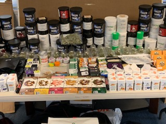 A search of the vehicle revealed 27.5 pounds of mariuana, 4.3 pounds of edible THC, 4.3 pounds of THC wax, 17 fluid ounces of THC infused Berry Lemonade, and assorted THC vaping cartridges.