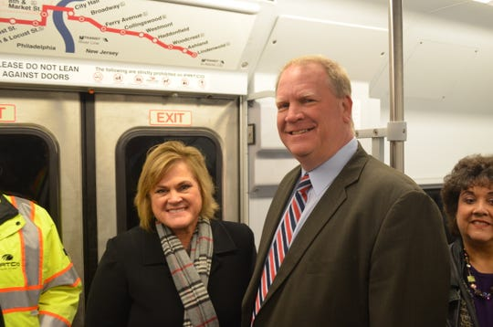 Acting Federal Transit Administration director K. Jane Williams and PATCO Hi-speedline General Manager John Rink ride a PATCO train in Philadelphia during a visit to announce a major grant to help reopen the long-closed Franklin Square Station in the city.