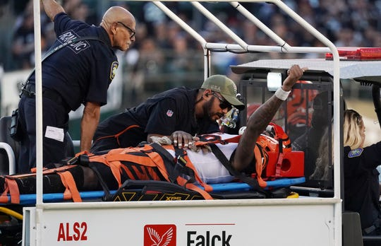 Nov 17, 2019; Oakland, CA, USA; Cincinnati Bengals wide receiver Auden Tate (19) is taken off the  field on a cart by medical personnel after suffering a neck in jury in the fourth quarter against the Oakland Raiders at Oakland-Alameda County Coliseum. The Raiders defeated the Bengals 17-10.
