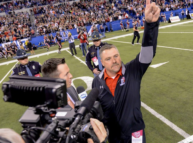 East Central head coach Justin Roden points at the fans after beating Lowell 14-7 in the IHSAA State Final, Lucas Oil Stadium, Indianapolis, IN, Saturday, Nov. 25, 2017