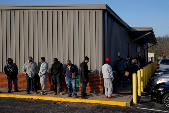 Lines for REAL ID registration and other services wind around the corner of the driver services center in Clarksville, Tenn., on Monday, Nov. 18, 2019.