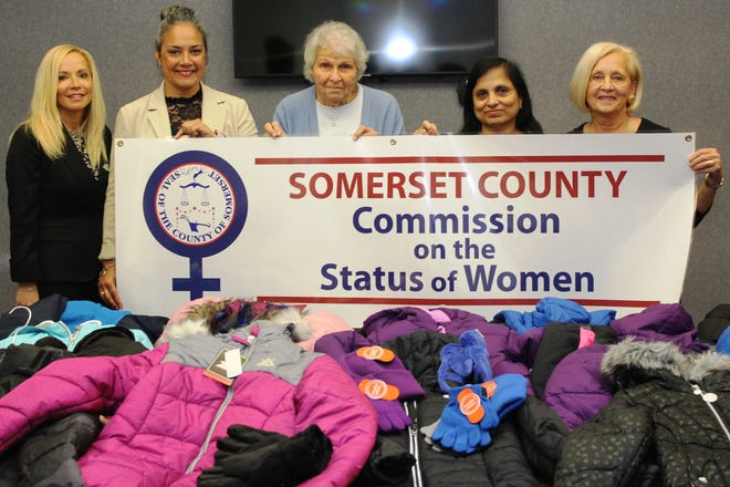 Pictured (left to right) with some of the donated coats are Somerset County Commission on the Status of Women members Janice Fields and Stella Ayala; Food Bank Network Executive Director Marie Scannell; Freeholder Deputy Director Pat Walsh; and commission member Smriti Agrawal.