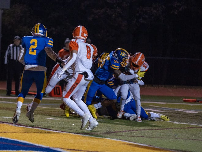 North Brunswick's Leon Lowery (15) makes a tackle in the Central Group V semifinal against Cherokee
