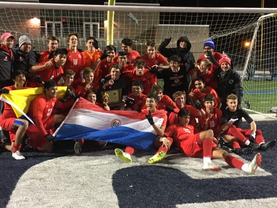 The Bernards soccer team celebrates after winning the 2019 Group II championship