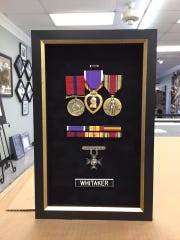 Channing Whitaker was awarded several medals for his service in World War II, including the Purple Heart, a Marine Corps Good Conduct Medal and an Asiatic-Pacific Campaign Medal.