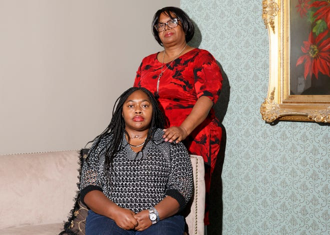 Lakeisha Cherry, 32, left, and her mother, Jacqueline Cherry, 53, pose for a photograph on Nov. 17, 2019 at The Rasor Law Firm in Royal Oak.
