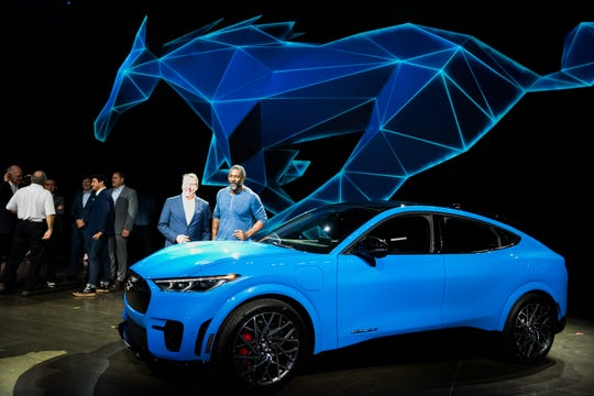 Actor Idris Elba and Bill Ford, executive chairman of Ford Motor Co., introduce the all-electric Mustang Mach-E SUV Sunday night  in Los Angeles, California.