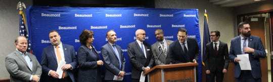 Elected officials and community leaders at a news conference on Nov. 18, 2019 announcing a new regional transit initiative at Beaumont Hospital in Royal Oak.