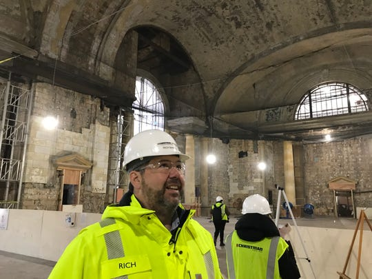 Rich Bardelli, construction manager for Ford's restoration of the Michigan Central Station, shows visitors around the station on Nov. 18, 2019.