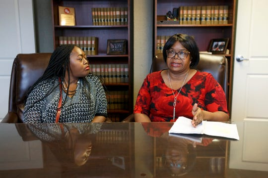 Lakeisha Cherry, 32, left, listens to her mother, Jacqueline Cherry, 53, right, recall their time in the hospital on Nov. 17, 2019 at The Rasor Law Firm in Royal Oak.