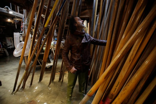 Paolo Brandolisio stands in his oars flooded laboratory, in Venice, Italy on Sunday. Venetians are fed up with what they see as an inadequate to the city's mounting problems: record-breaking flooding, damaging cruise ship traffic and over-tourism.