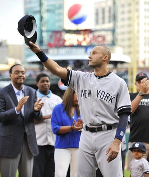 Kalamazoo native Derek Jeter tips his cap to the Comerica Park crowd before a game in 2014.