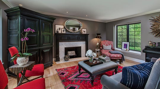 This freshly remodeled living room satisfies the senses in a subtle way. Repainted surfaces include the stately armoire and the fireplace mantel. Flowers and plants introduce a natural aroma.