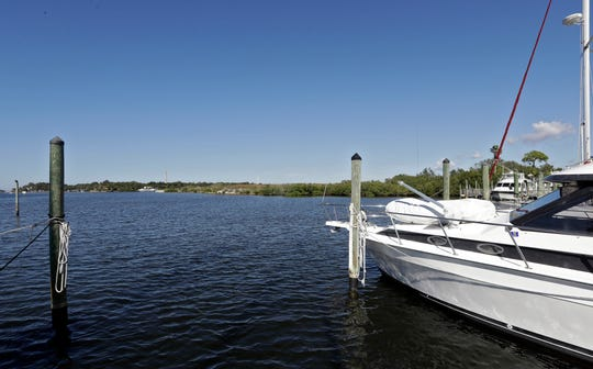 Boats are moored in the Anclote River near the old Stauffer chemical plant site in Tarpon Springs, Fla. in 2017.