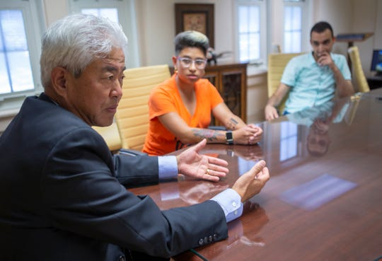 Chunsheng Zhang, senior provost for international affairs at University of North Alabama, speaks with international students Melissa Bonilla Parra, from Costa Rica and Faouzi Seba from Algeria.
