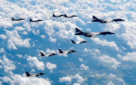 In this Sept. 18, 2017, file photo provided by South Korea Defense Ministry, U.S. Air Force B-1B bombers, F-35B stealth fighter jets and South Korean F-15K fighter jets fly over the Korean Peninsula during joint drills.