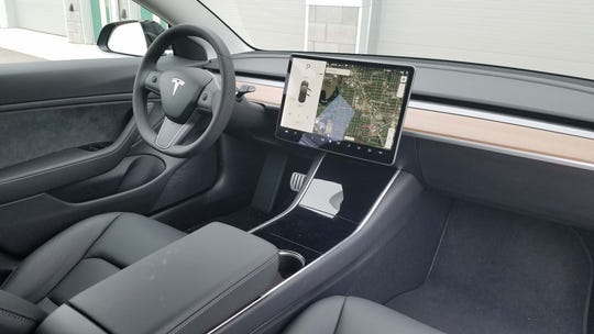 The interior of the Tesla Model 3 Performance is little different than other Mod3 models with simple layout and black seats.