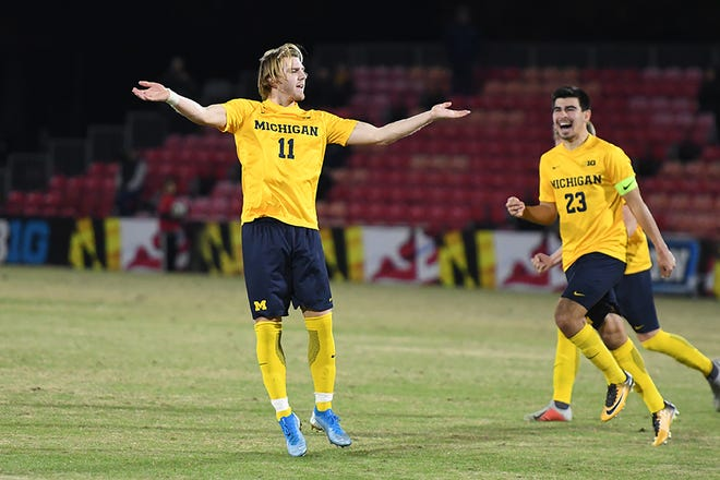 Michigan's Jack Hallahan (11)  is second in team scoring with five goals and six assists.