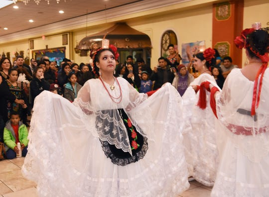 Valeria Rivera of the Ballet Folklorico Moyocoyani Izel dances with her group during the Holy Mole event at El Kiosko banquet hall.