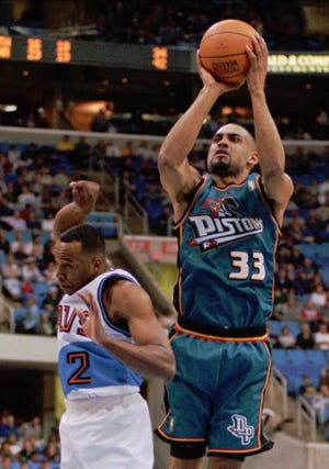 Grant Hill (33) sports the teal jersey the Pistons started wearing in the 1996-97 season.