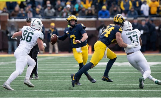 Michigan quarterback Shea Patterson threw for 384 yards against Michigan State, and was the recipient of a late hit from Michigan State's Jacub Panasiuk.
