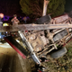 A truck overturned and snapped a utility pole in half in a single vehicle crash Sunday night that sent two to the hospital.