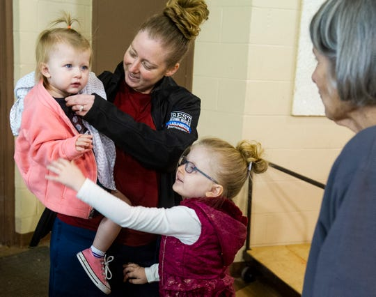 Stephanie Crawford of Evansville, center, drops off a box of gifts for Operation Christmas Child with her daughters Camille, 1, left, and Paisley, 4, at First Baptist Church in Evansville, Monday afternoon. The organization will be accepting donations at First Baptist Church until Nov. 25.