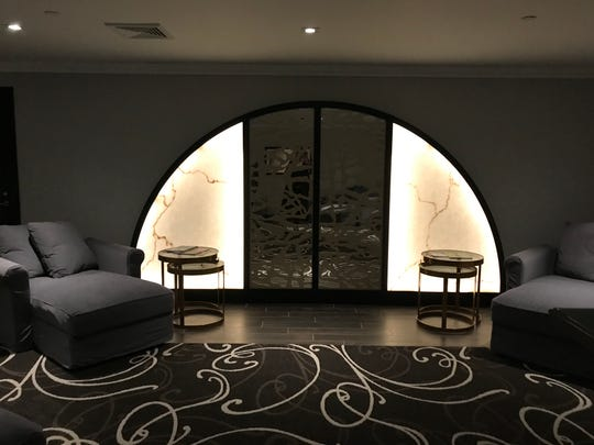 Hotel Retlaw's spa includes a relaxation room fit with dim lighting and calming instrumental music.