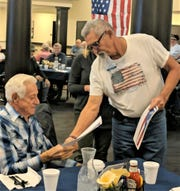 Veteran Robert Snyder received a pin at Valley View Health Campus from Mike Amore, volunteer with ProMedica Heartland Hospice.